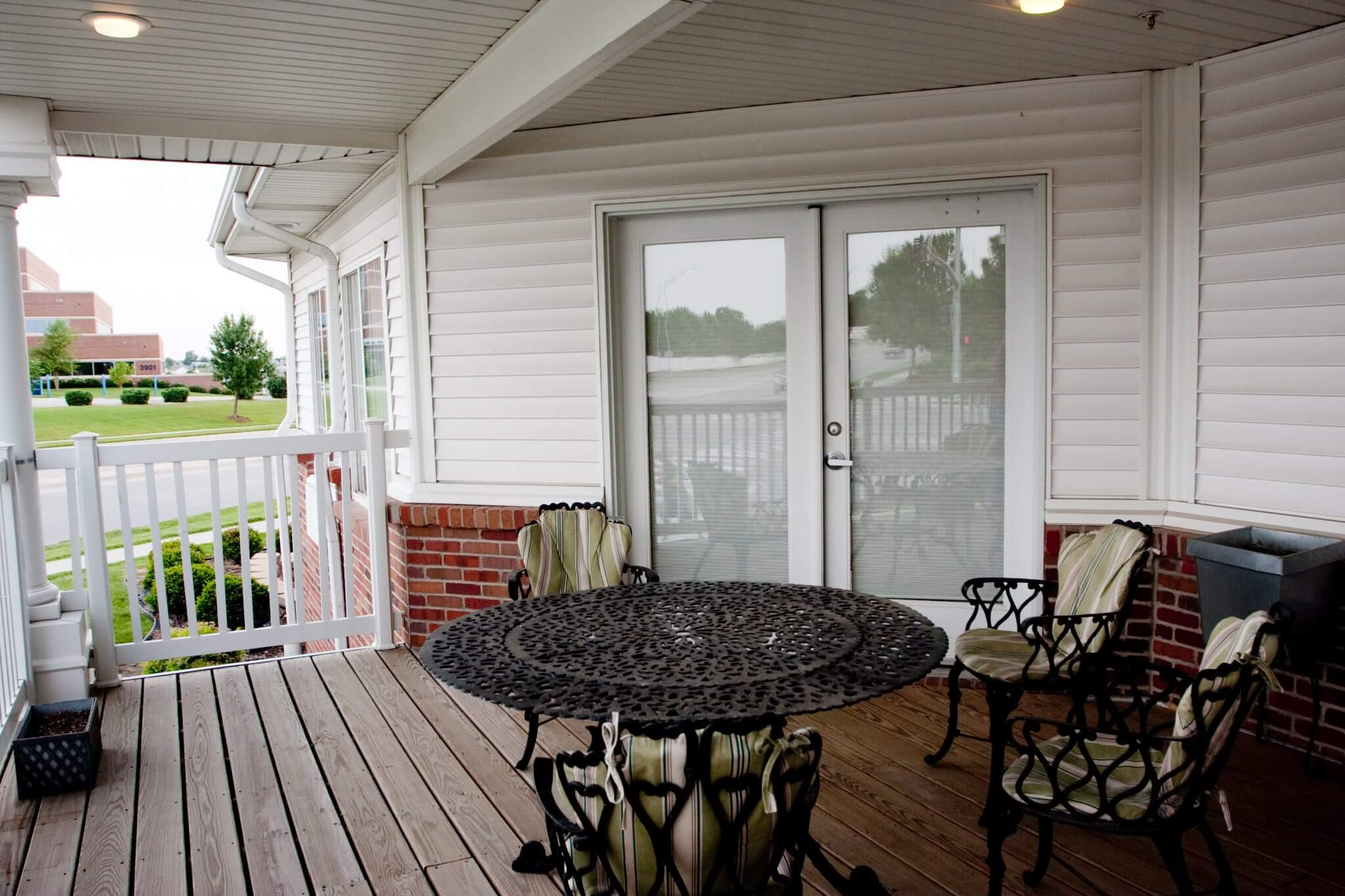 wooden porch with table and chairs