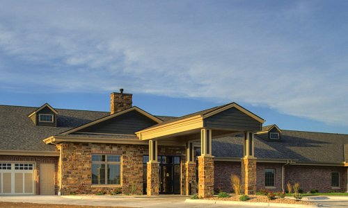 The Waterford Wilderness Hills Memory Care Facility exterior at sunset
