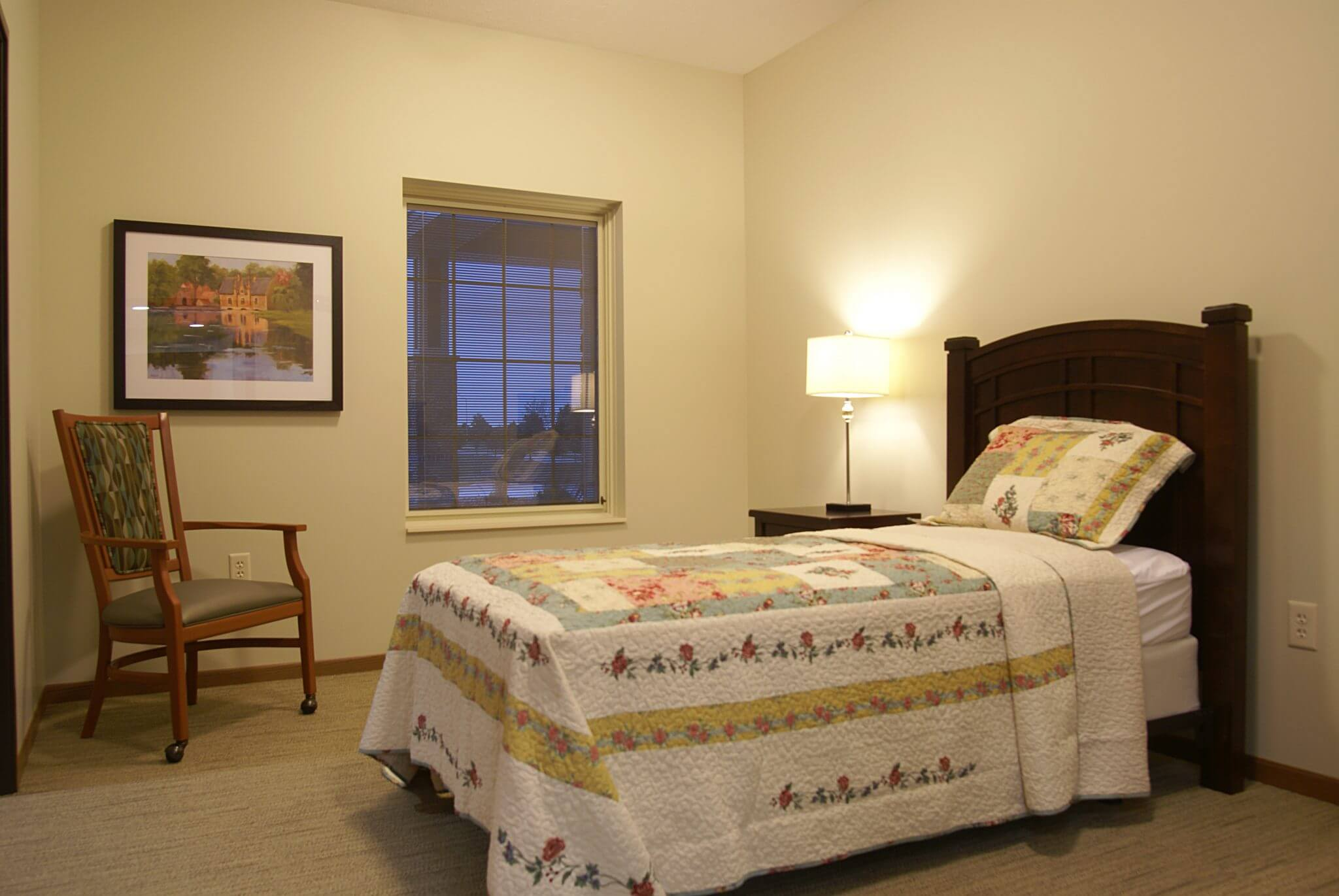 interior shot of bedroom with quilt on bed