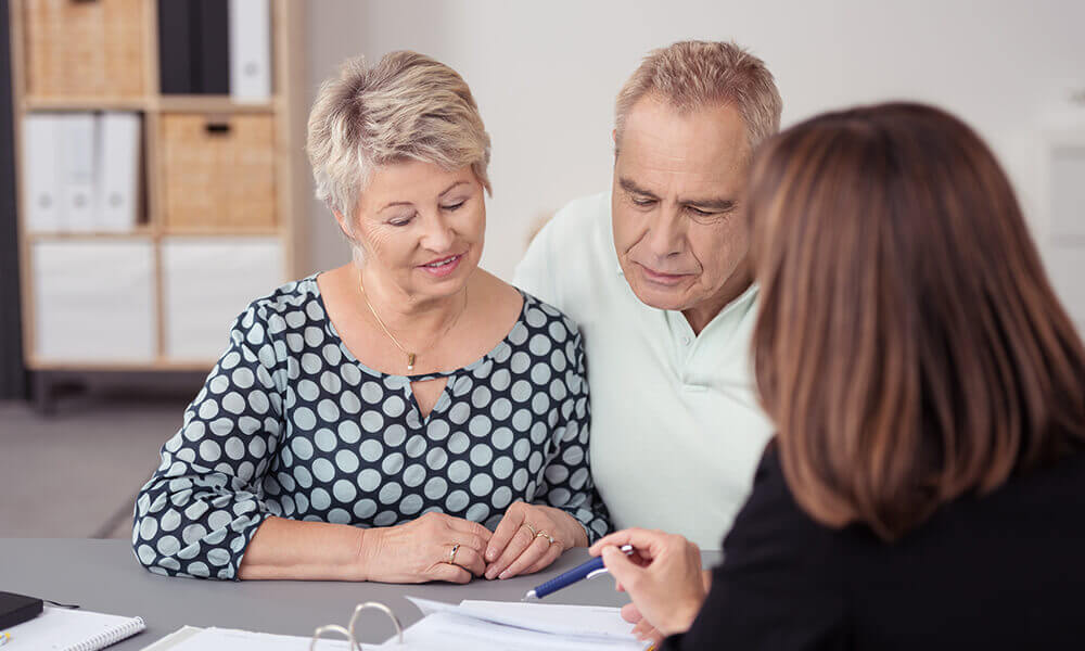 woman sitting down to talk finances with her parents