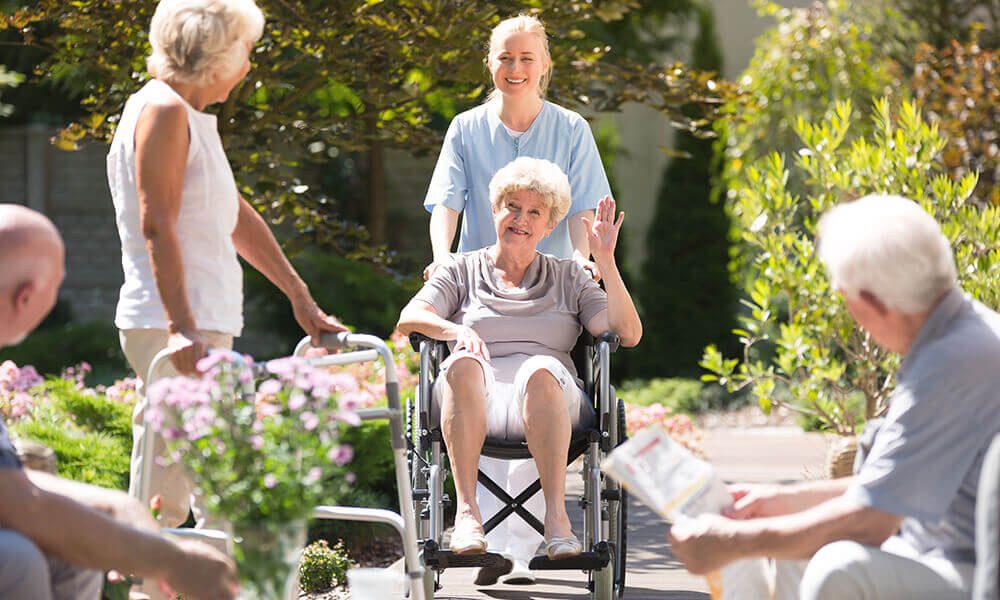 an elderly woman touring an assisted living community
