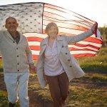 elderly couple celebrating the fourth of july