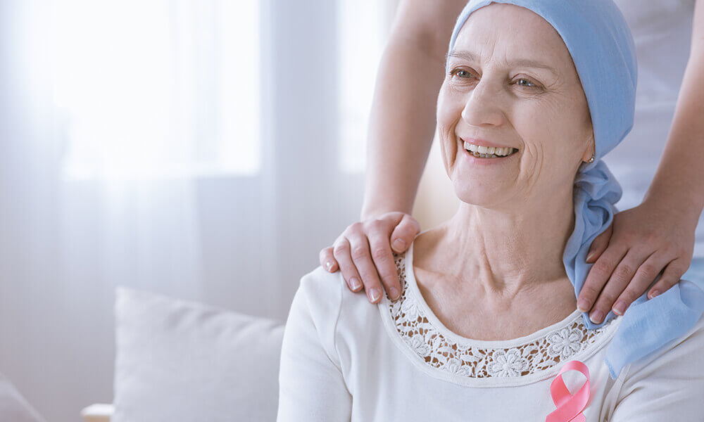 an elderly woman suffering from breast cancer
