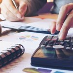 family member calculating costs for assisted living facility