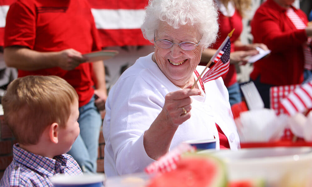 elderly woman celebrates the fourth of july