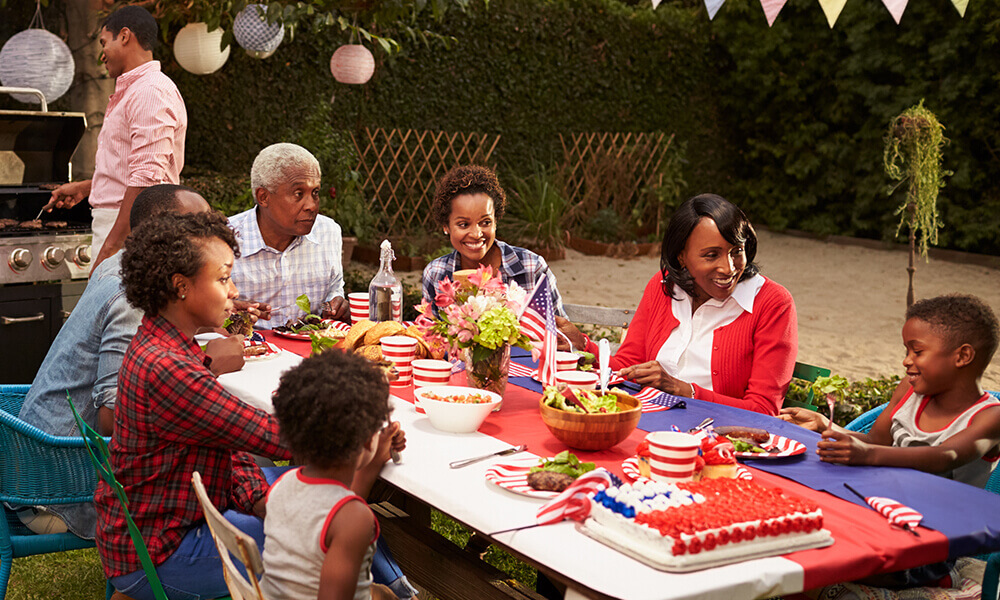 family celebrating the fourth of july with their grandparent