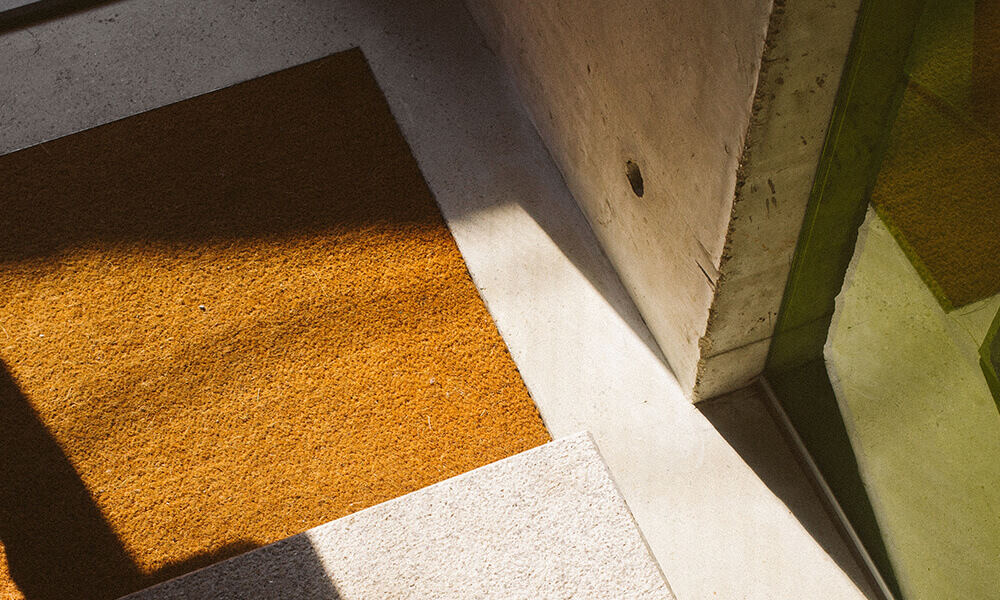 a doormat on a well lit entryway